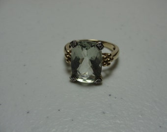 Vintage green amyathyst set in 14k gyellow gold stone14mmx10mm  8.48 carats  size 7