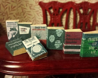 Set of 8 vintage 1.12 scale miniature George Orwell novels with aged turnable blank pages and bookmark.