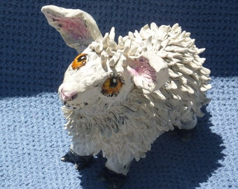 fluffy sweet sheep handmade in USA from a lump of clay totally unique