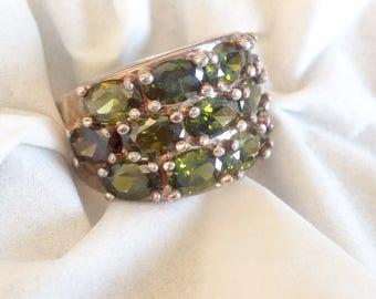 Sterling silver 9 peridot triple row fancy lady's ring. Size 5.75 - 6.