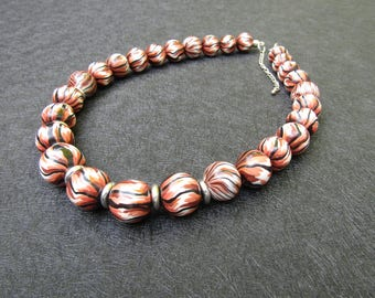 Brown, white and black polymer clay beaded necklace