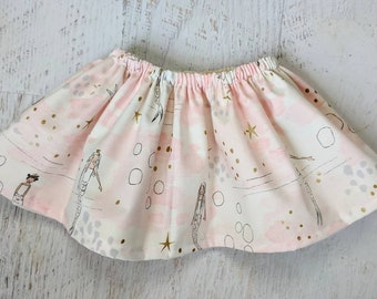Pink mermaid skirt, pink white background with gold details