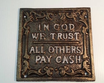 Brown, gold Cast Iron In God we Trust