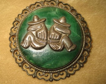 Mexico silver Malachite brooch ornate setting of two mexicans men wearing sombreros sitting together