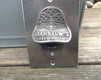 Marston's cast iron bottle opener mounted on industrial steel plate