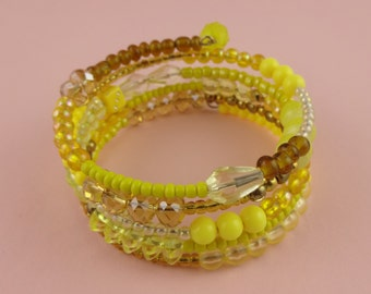 Yellow and Gold Memory Wire Bangle - Stacked coil bracelets with mixed beads in warm, sunny colours - cheerful happy summer boho jewellery