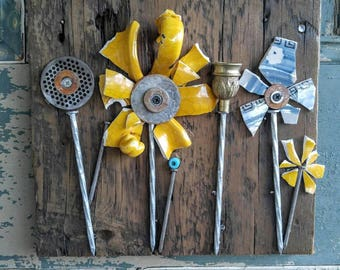 Up-cycled, broken pottery, flower wall hanging in yellow and blue