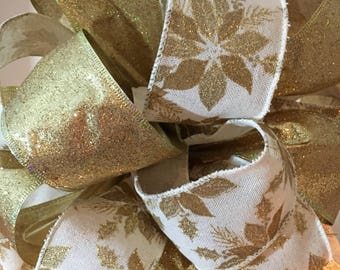 Large Christmas Tree topper bow off white burlap ribbon with gold poinsettias and a matching gold glitter ribbon