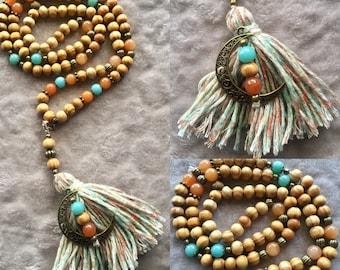 Orange Aventurine and natural wood mala necklace