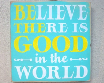 Believe there is good in the world.  BE THE GOOD.   Wooden hand painted sign. Tourquoise with yellow and white
