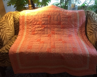 Lap or baby quilt in coral and white