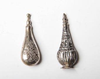 Silver perfume bottle with screw top. Indian