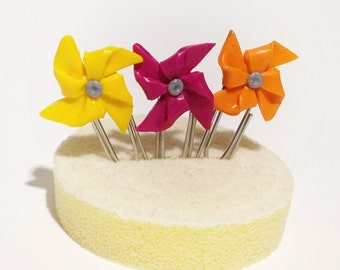 Three mini pinwheels paper clip