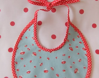 Handmade baby bib in 'Walk in the Woods' toadstool fabrics