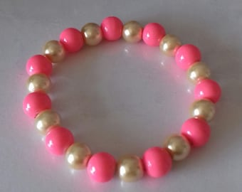Pink and gold stretch bead bracelet