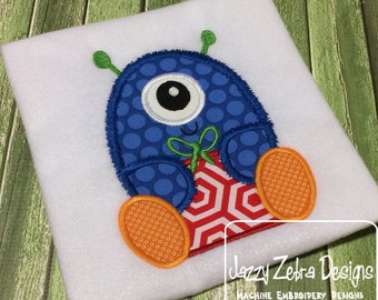 Monster with gift or present appliqué embroidery design - monster appliqué design - Christmas appliqué design - gift appliqué design