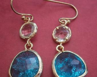 D289) A lovely pair of gold tone metal light blue open back glass pierced drop earrings