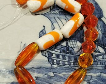 Vintage glass Czech beads. Main color orange