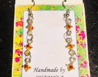 Beautiful handmade silver earrings with orange crystal beads