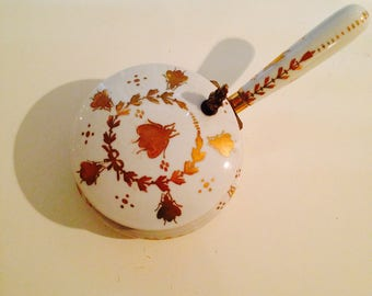 White ceramic lidded box with gold painted insects