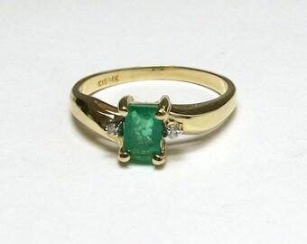 columbian emerald engagement ring emerald cut in 14k yellow gold