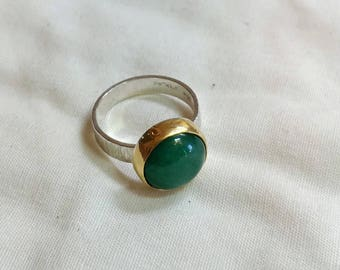 Aventurine cabochon with a 22kt. Bezel on a sterling silver back and ring.   jewelrybyjohndesign