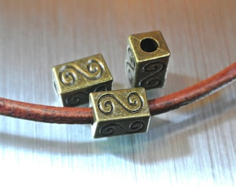 Set of 6 beads bronze rectangular tubes passing 10 x 6 x 6 mm, volute decor, hole: 3.2 mm to 3 mm cord