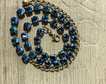 Prom Anyone? 36 box Swarovski Crystal 13-18 inch  Necklace in a oxidized brass setting and 36 Metallic Blue 6 mm stones.
