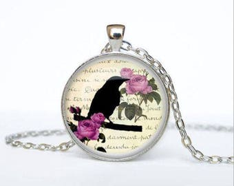 The bird glass cabochon and chain necklace