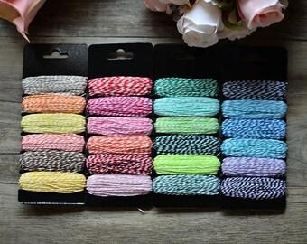 6 7.5 m sprockets of baker's twine cotton thread.