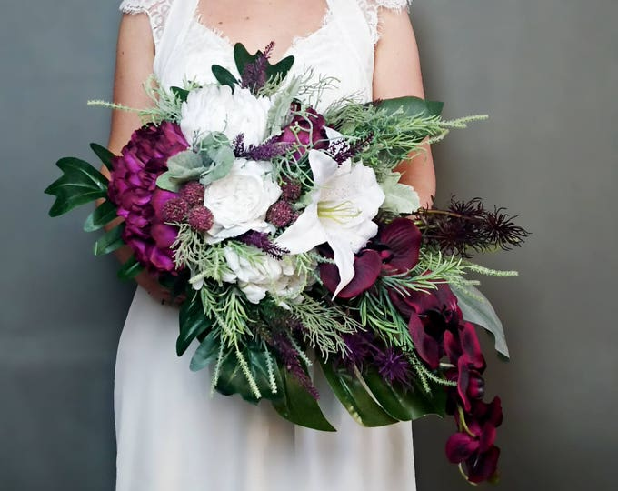Plum purple white tropical flowers winter wedding bridal bouquet cascade greenery orchid lily rose monstera banana leaf grasses big original