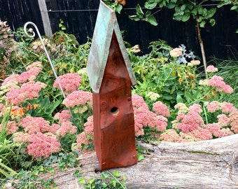 Hand carved Birdhouse with copper roof