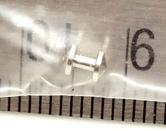 Dermal Anchor 14g surgical stainless steel listing rounded on one end slightly spiked on the other.