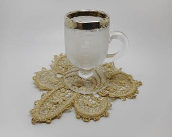 A novelty match holder in the shape of a cup. 1906