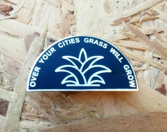Over Your Cities Grass Will Grow enamel pin in gold and black