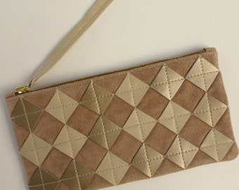 Pearly ivory leather zip pouch. Repurposed pearly diamond chips on tan suede, brass zipper, fully lined.