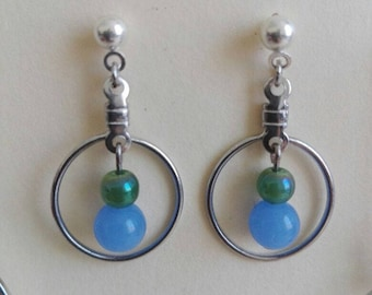 Earrings with green and light blue pearls