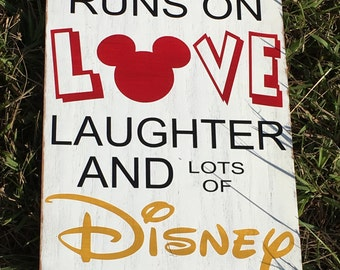 This Home Runs On Love Laughter and Disney Wooden Wall Sign