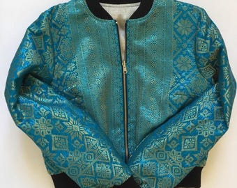 Turquoise and gold jacquard and denim reversible, cropped bomber jacket