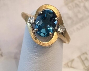 Vintage 14k yellow gold Oval 8x6mm Blue Topaz and 2 Round Diamond Halo Bypass Ring app. 1.38 tw, size 6.75, With Satin Finish