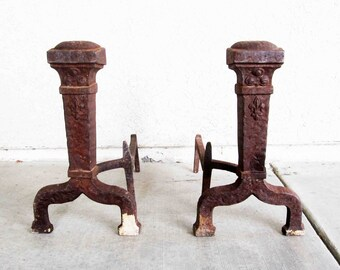 Vintage Cast Iron Andirons in Arts and Crafts Style with Fleur De Lis. Circa 1910's - 1920's.
