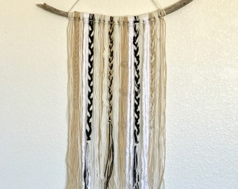 Hints of black yarn wall hanging