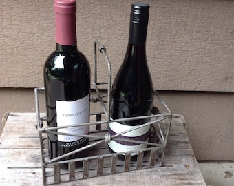 Vintage handmade metal wine bottle carrier