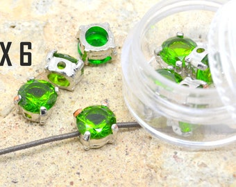 rhinestone 6 x 8 mm silver plated metal and green CZ