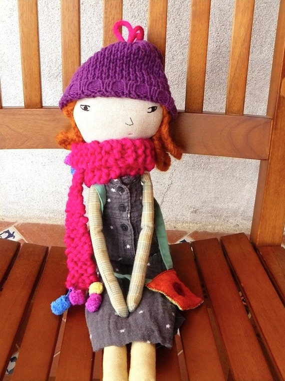 Heirloom linen and cotton doll with a lot of outfits (dresses, shirts, skirts, pants, woven bag and scarf). 19 inches.
