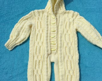 beautiful hand knitted cable stitch baby all in one