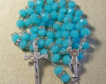 Women's Catholic rosary with opaque aqua blue crystal rondelles with rhinestone accents
