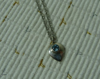 Silver necklace with sky blue sterling silver pendant.