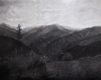 Reverse charcoal drawing of California mountains