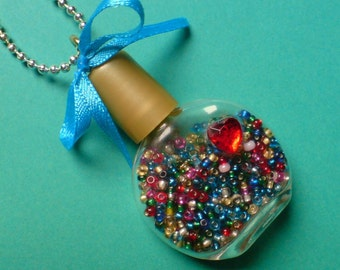 Miniature Bottle of Beads Pendant Necklace - small glass bottle with red heart & golden lid, full of tiny rainbow multi-coloured seed beads